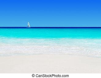Yacht under sail at Anse Georgette beach, Praslin island,...