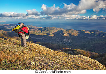 Photographer takes pictures on top of the mountain in...