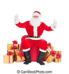 Santa Claus with many gift boxes around, thumbs up hand...