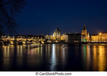 Night photo of Prague Charles Bridge and Powder tower -...