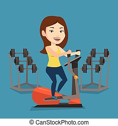 Woman exercising on elliptical trainer. - Caucasian woman...