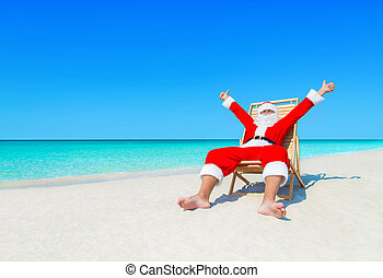 Christmas Santa Claus on sunlounger satisfied with tropical beach holiday