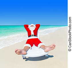 Christmas Santa Claus relax on sunlounger at ocean perfect...