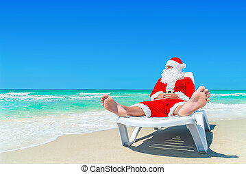 Christmas Santa Claus relax on sunlounger at ocean tropical...