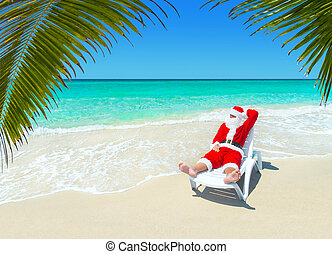Christmas Santa Claus relax in sunlounger at tropical sandy...