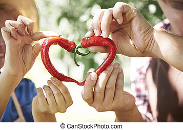 Really hot love sign of peppers