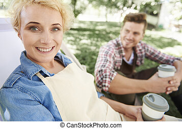 Woman having a rest with coffee cup in hands