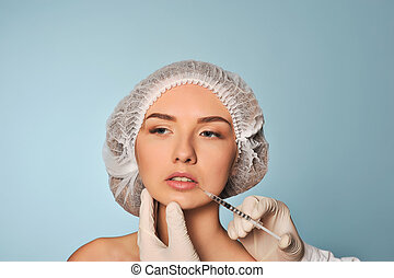 Beauty woman giving medical injections. The procedure...