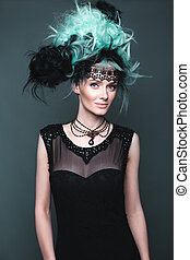 Beautiful girl in evening dress with avant-garde hairstyles....