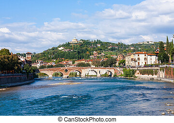 Ponte Pietra bridge on Adige River in Verona - travel to...