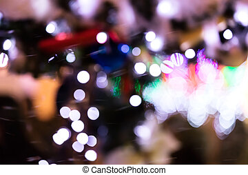 abstract blurred bright holiday lights in night city