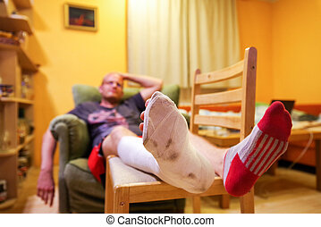 Frustrated man with broken leg