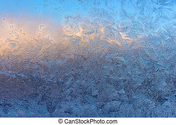 Frozen window glass - Abstract ice pattern on winter glass