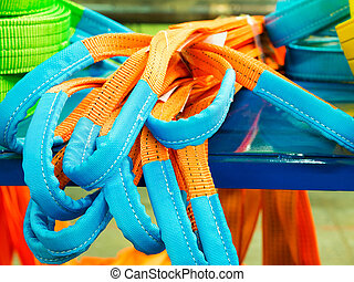 Colorful nylon soft lifting slings stacked. Products for...