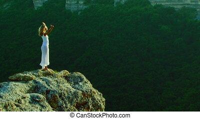Girl among mountain nature