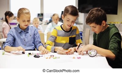 happy children learning at robotics school - education,...