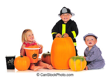 Halloween Siblings - Three happy young children dressed for...