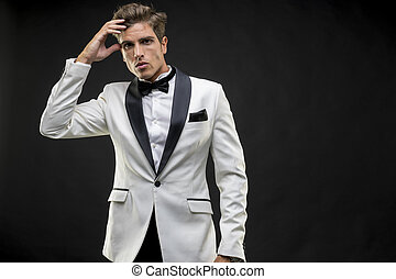Elegant and handsome man dressed in tuxedo for New Year's...
