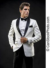 Evening, Elegant and handsome man dressed in tuxedo for New...