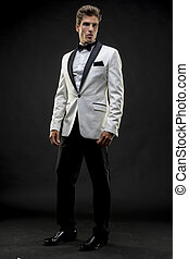Celebration, Elegant and handsome man dressed in tuxedo for...
