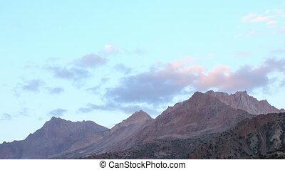 Clouds in light the setting sun. Time Lapse. Tajikistan
