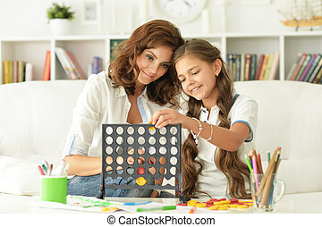 girl playing with her mother