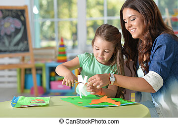 Mother teaches kid to do craft items - Mother teaches her...