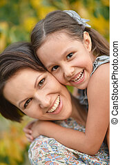 Portrait of mother and daughter - Portrait of laughing young...