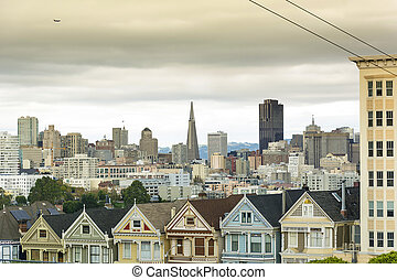Painted Ladies with downtown in the background - Victorian...