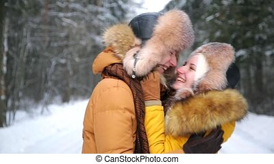 Happy Young Couple in Winter kissing.