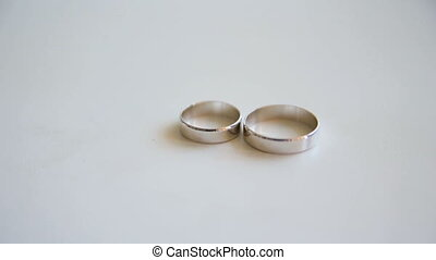 Wedding rings shine in the sun.