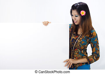 Asian women with Traditional Kebaya holding a blank sign