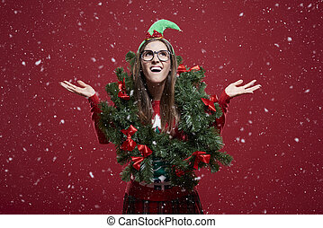 Funny woman with Christmas garland in the snow