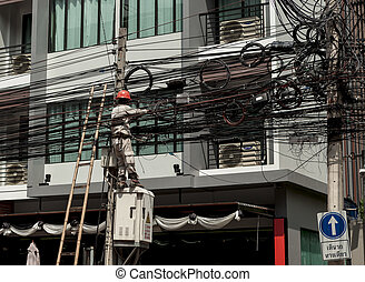 Electric.Working man repairs an electrical malfunction in...