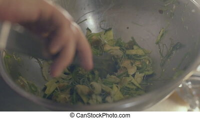 Chef is prepare fresh seaweed salad, close up - Chef is...