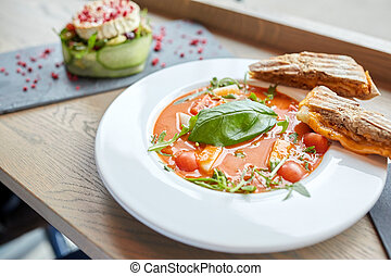 plate of delicious gazpacho soup at restaurant - food,...