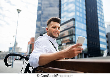 happy man with smartphone and bicycle in city - people,...