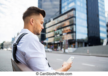 man with smartphone and bicycle in city - people,...
