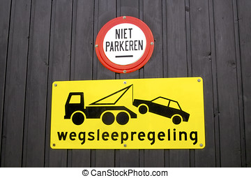 Dutch tow away sign on a garage door in Holland