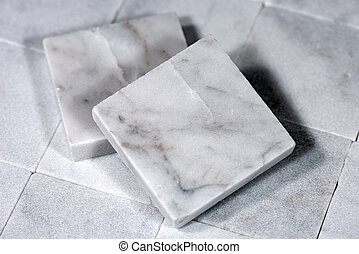 Square Tiles of White Carrara Marble - Detail of two small...