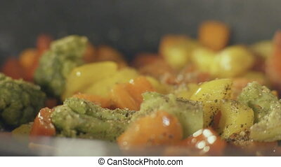 Stir fried vegetables in the pan, close up