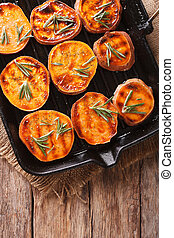 Grilled sweet potatoes with rosemary on the grill pan...