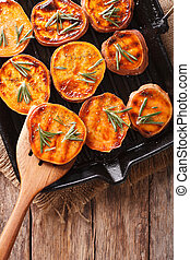 Healthy food: Grilled sweet potatoes with rosemary on the...