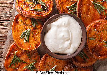Grilled sweet potatoes with sour cream closeup. horizontal...