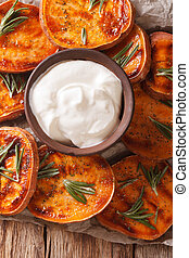 Grilled sweet potatoes with sour cream closeup. vertical top...