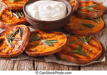 Grilled sweet potatoes with sour cream closeup. horizontal -...