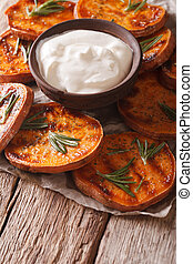 roasted sweet potato with sour cream closeup. vertical -...