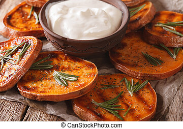 Healthy food: grilled sweet potatoes with rosemary served...