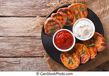 grilled sweet potatoes with rosemary served with sour cream...