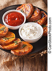 roasted sweet potato with sour cream and ketchup closeup....